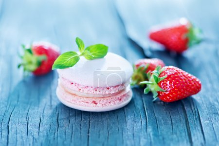 Photo for Strawberry macaroons and fresh berries on a table - Royalty Free Image