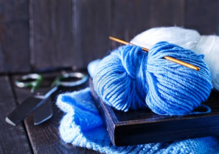 Knitting on wooden tray