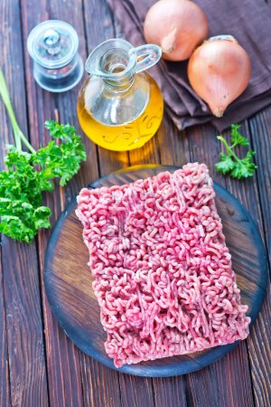 Photo for Raw minced meat on the wooden board - Royalty Free Image