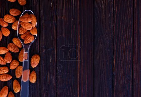 dry almonds in spoon