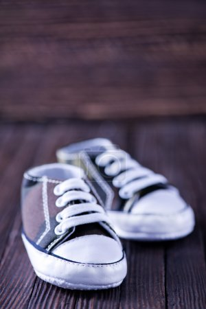 baby shoes on the wood