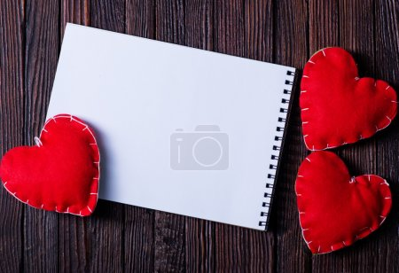 notebook and red hearts