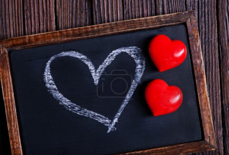 red hearts and blackboard