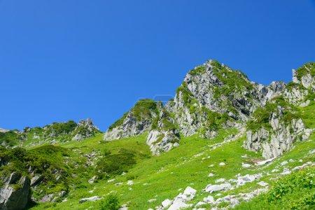 """Photo pour Le mont Kisokoma est une montagne située dans le sud de la préfecture de Nagano. Il mesure 2 956 m de haut et est le plus haut sommet des monts Kiso (Alpes centrales). Il est également inclus dans la liste des """"100 célèbres montagnes japonaises ."""" - image libre de droit"""