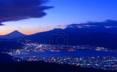 Lights of Suwa city and Mt.Fuji at dawn