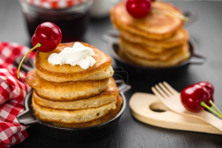 Pancakes with cherry and sour cream...