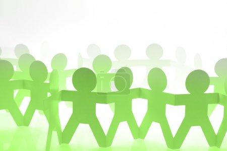 Green team holding hands
