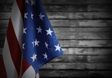 Photo for Closeup of American flag in front of wooden background - Royalty Free Image