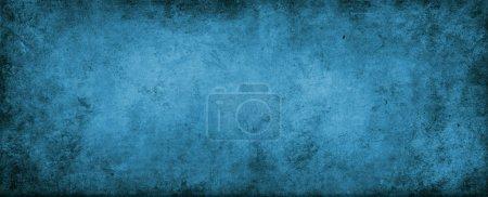 Photo pour Gros plan du mur bleu grunge - image libre de droit