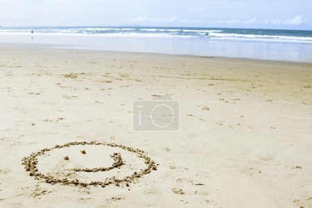 Photo for Face made on sand at beach - Royalty Free Image