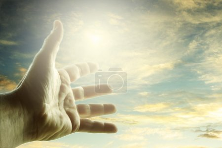 Photo for Hand reaching for the sky - Royalty Free Image