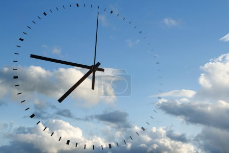 Photo for Clock face in blue sky - Royalty Free Image