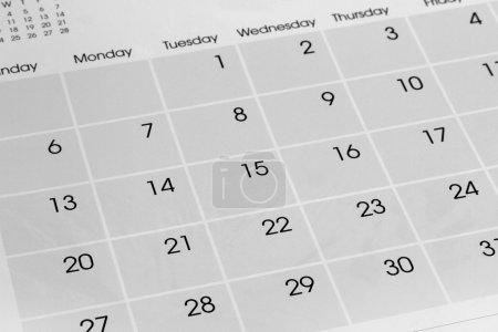 Photo pour Gros plan de numéros sur la page calendrier - image libre de droit