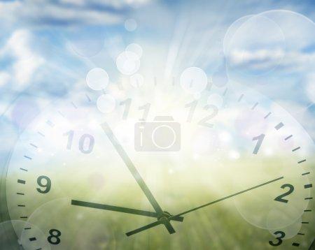Photo pour Horloge visage dans le champ de printemps - image libre de droit