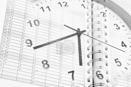 Time management. clock and diary