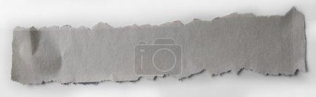 Torn grey paper