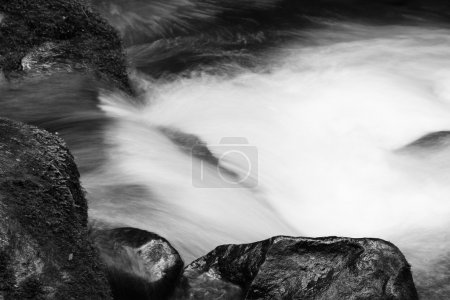 Photo for Fast flowing mountain stream and rocks - Royalty Free Image