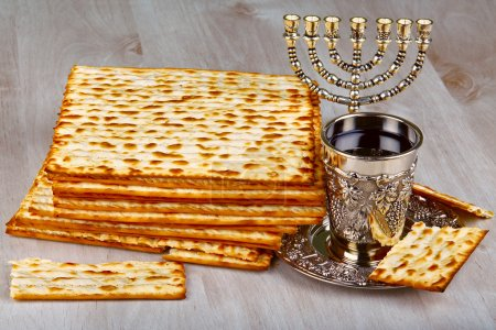 Photo for Passover matzo with kiddush cup of wine on wooden table - Royalty Free Image