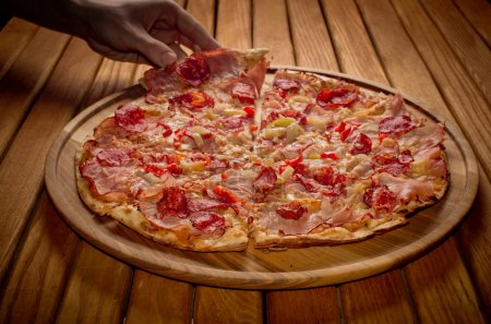 Fresh Baked  Pizza  on Wooden table