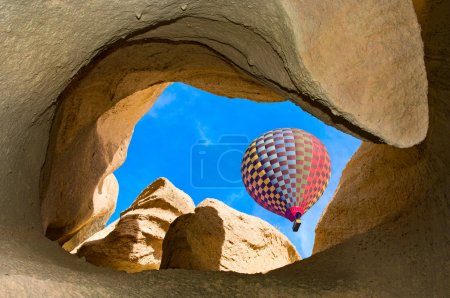 Photo for Hot air balloon over mountain landscape in Cappadocia, Goreme National Park, Turkey. - Royalty Free Image