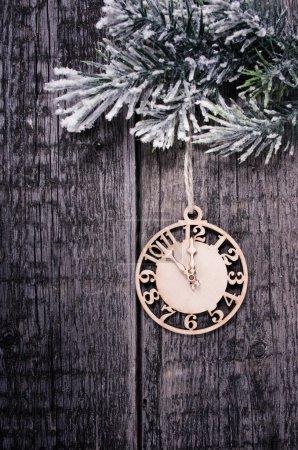 Clock on fir tree branch