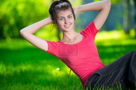 Woman doing exercises for abdominal muscles