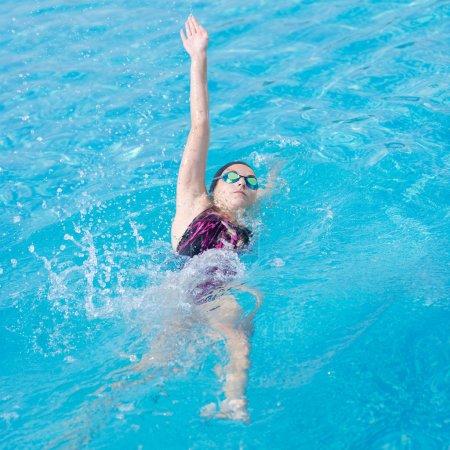 Woman swimming back crawl style