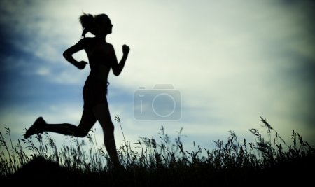 Photo for Young lady running. Woman runner running through the summer park rural road. Workout in a park. Beautiful fit girl. Fitness model caucasian ethnicity outdoors. Weight loss exercise. Jogging. - Royalty Free Image