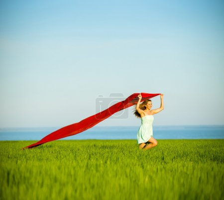 Photo for Young lady runing with tissue in green field. Beautiful happy woman walking in the summer rural meadow. Beautiful fit tan girl. Sexy slim model caucasian ethnicity outdoors - Royalty Free Image