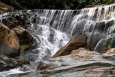 Waterfall in deep rain forest jungle. (Mae pool Waterfall in Uttaradit Province, Thailand)