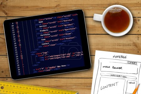 Photo for Website wireframe sketch and programming code on digital tablet screen - Royalty Free Image