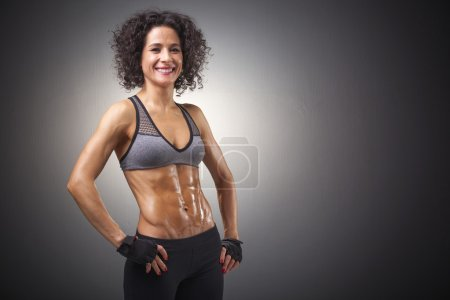 Happy smiling fitness woman posing