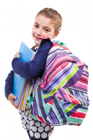 student girl holding notebooks and backpack