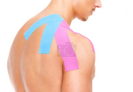 Muscular man with kinesio taping