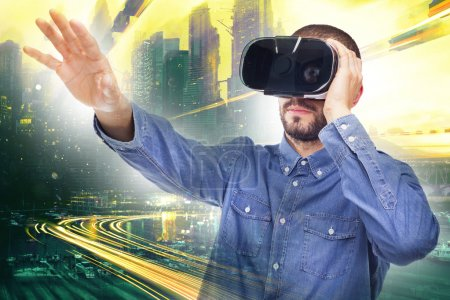 Photo for Man experiencing virtual reality through a VR headset - Royalty Free Image