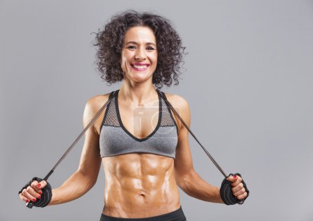 smiling fitness woman with jumping rope