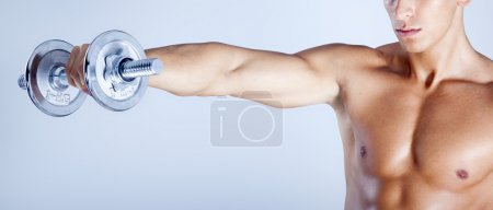 Photo for Fitness man lifting weights on gray background - Royalty Free Image