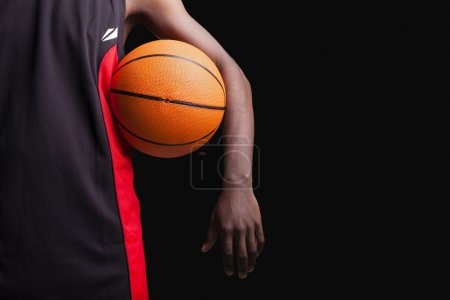 Basketball player with basket ball