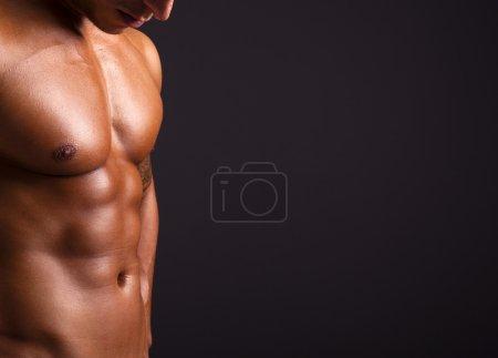 Beautiful man torso on black background