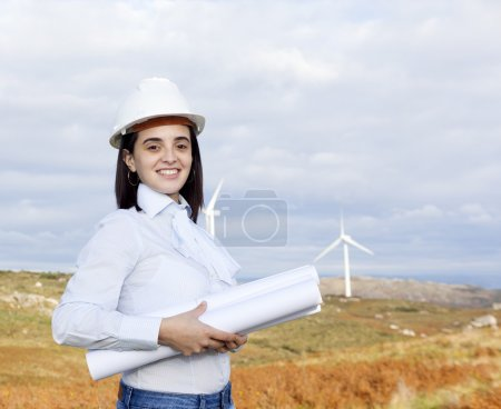 Female engineer holding blueprints