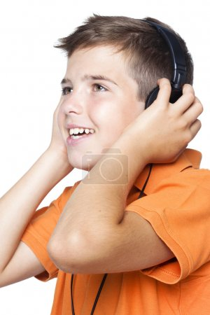 Smiling boy with headphones listening to music
