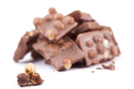 Photo for Milk chocolate with hazelnuts on white background - Royalty Free Image