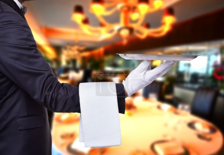 Waiter holding a tray at a luxury restaurant