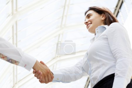 Smiling businesswoman giving a handshake