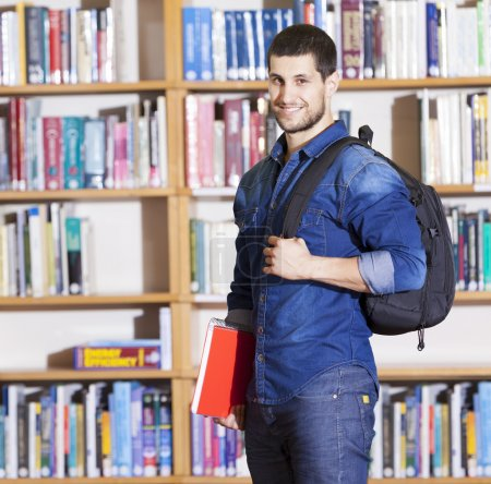 Male student smiling at the library