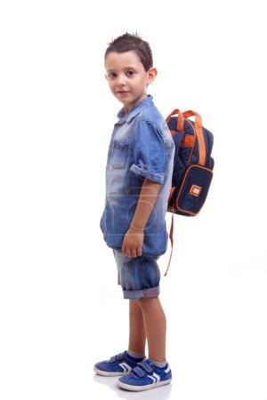 School kid standing on white background
