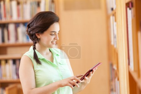 female student using a tablet computer