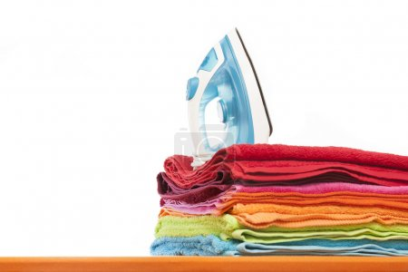 Ironing board with colorful towels