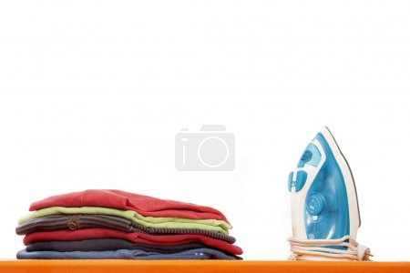 Ironing board with clothes