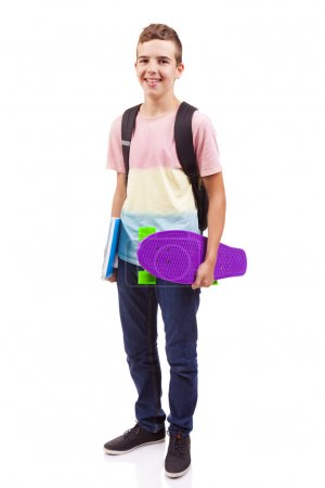 school boy holding a skateboard and notebooks
